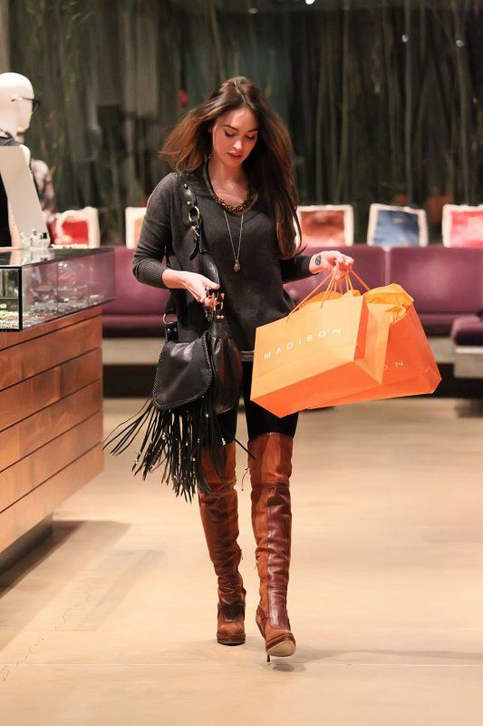 Megan Fox in knee boots shopping at Madison