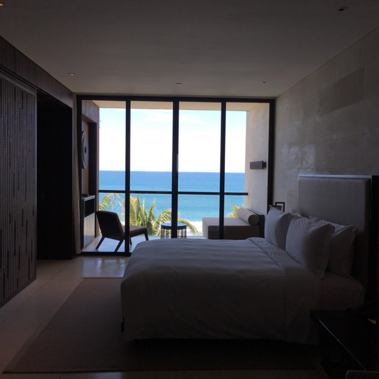 My room with ocean view, a terrace and a big King Koil bed.