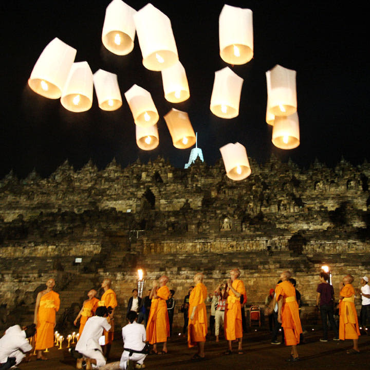 MAGELANG, CENTRAL JAVA, INDONESIA - MAY 28: Buddhist monks release lanterns into the air on Borobudur temple during Vesak Day, commonly known as 'Buddha's birthday', at the Borobudur Mahayana Buddhist monument on May 28, 2010 in Magelang, Central Java, Indonesia. Annually, Buddhists in Indonesia celebrate Vesak at the monument, which makes it the most visited tourist attraction in Indonesia. It is observed during the full moon in May or June, with the ceremony centred at three Buddhist temples by walking from Mendut to Pawon and ending at Borobudur. The stages of life of Buddhism's founder, Gautama Buddha, which are celebrated at Vesak are his birth, enlightenment to Nirvana, and his passing (Parinirvana). (Photo by Ulet Ifansasti/Getty Images)