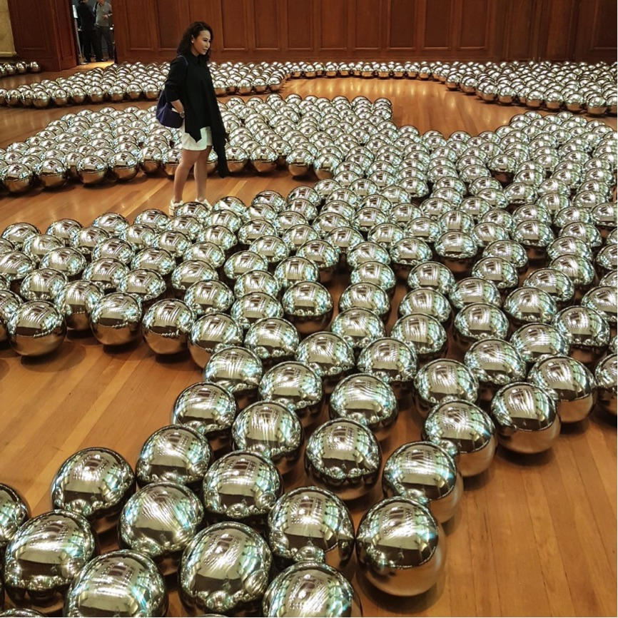 A sea of monochrome steel mirror balls. Everything in your life is a reflection of a choice you made. If you want a different result, make a different choice.